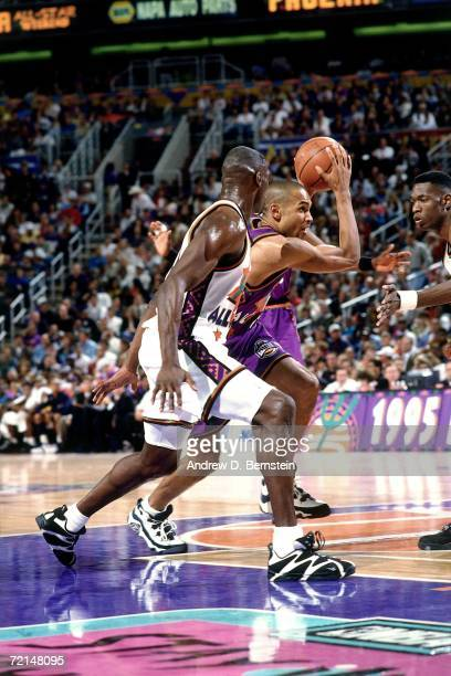 Grant Hill of the Eastern Conference AllStars drives to the basket against Shawn Kemp of the Western Conference AllStars during the 1995 NBA AllStar...