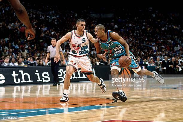Grant Hill of the Eastern Conference AllStars drives to the basket against Jason Kidd of the Western Conference AllStars during the 1996 NBA AllStar...