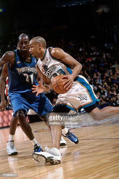 Grant Hill of the Eastern Conference AllStars drives to the basket against Kevin Garnett of the Western Conference AllStars during the 2000 NBA...