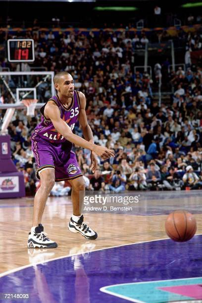 Grant Hill of the Eastern Conference All-Stars throws an entry pass against the Western Conference All-Stars during the 1995 NBA All-Star Game played...