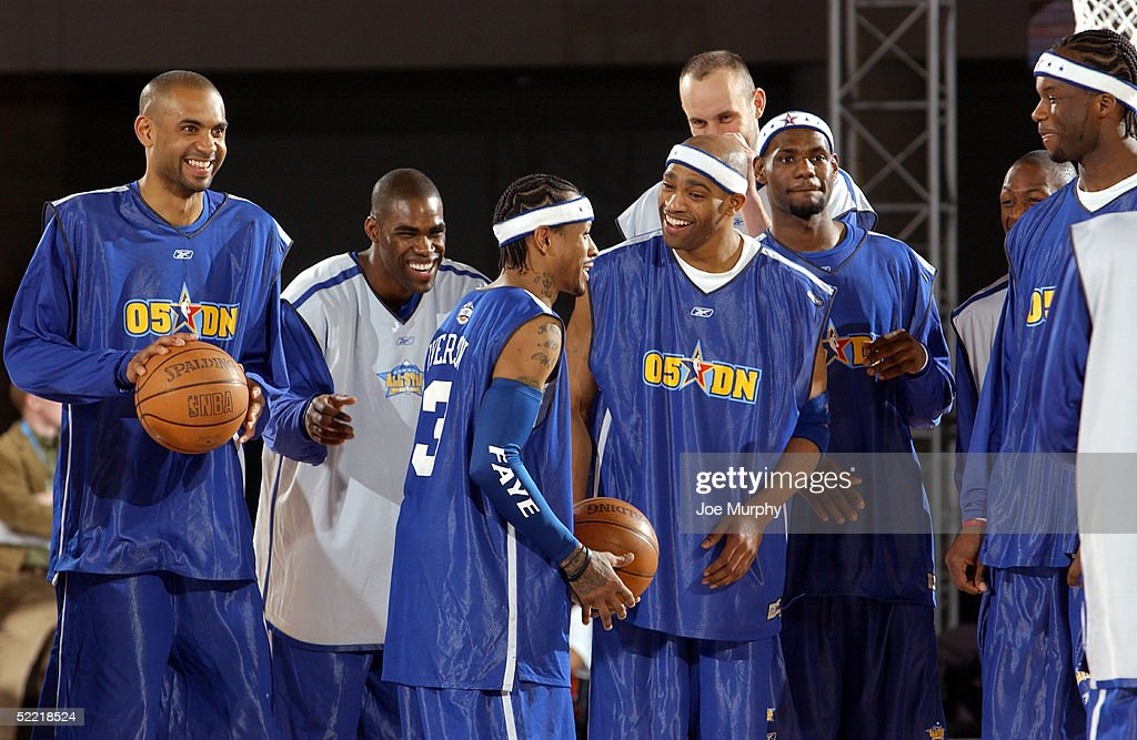 Grant Hill of the Orlando Magic, Antawn Jamison of the Washington Wizards, Allen Iverson of the Philadelphia 76ers, Vince Carter of the New Jersey Nets, and Zydrunas Ilgauskas, Lebron James of the Cleveland Cavaliers, and Jermaine O'Neal of the Indiana Pacers smile and laugh during the East All-Stars practice on Center Court in the Colorado Convention Center at Jam Session on February 19, 2005 in Denver, Colorado.