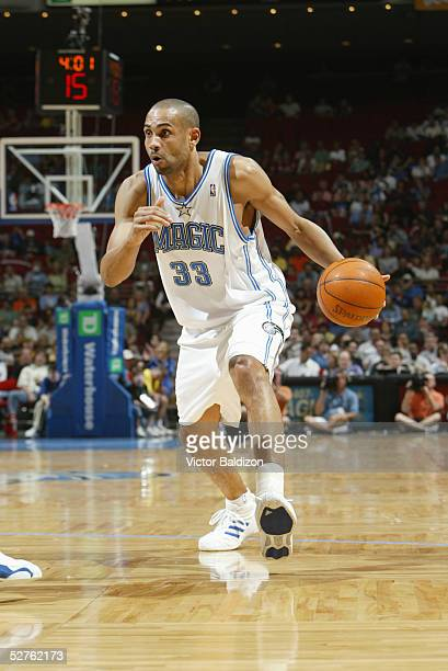 Grant Hill of the Orlando Magic dribbles against the Washington Wizards during a game at TD Waterhouse Centre on April 1 2005 in Orlando Florida The...