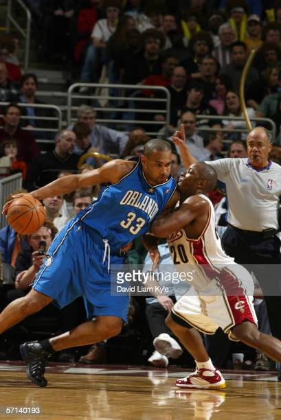 Grant Hill of the Orlando Magic drives against Eric Snow of the Cleveland Cavaliers during a game at Quicken Loans Arena on February 21 2006 in...