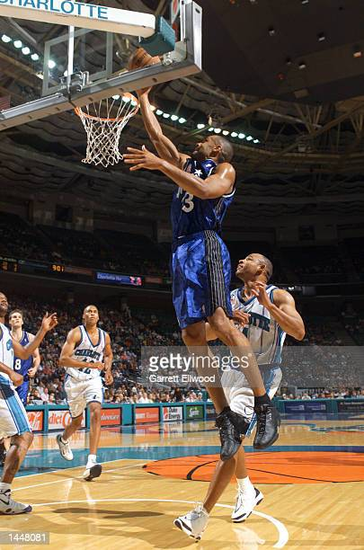 Grant Hill of the Orlando Magic drives to the basket against the Charlotte Hornets during a game at the Charlotte Coliseum in Charlotte North...