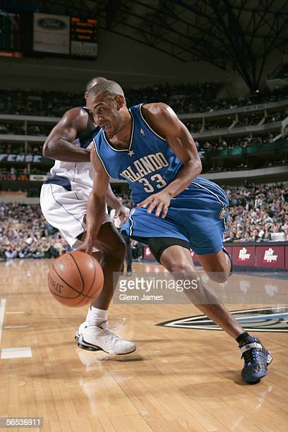 Grant Hill of the Orlando Magic drives to the basket during the game against the Dallas Mavericks at American Airlines Arena on December 16 2005 in...