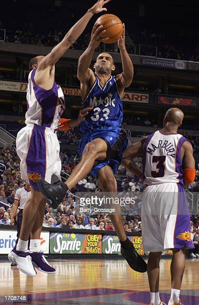Grant Hill of the Orlando Magic drives to the basket during the NBA game against the Phoenix Suns at America West Arena on December 16 2002 in...