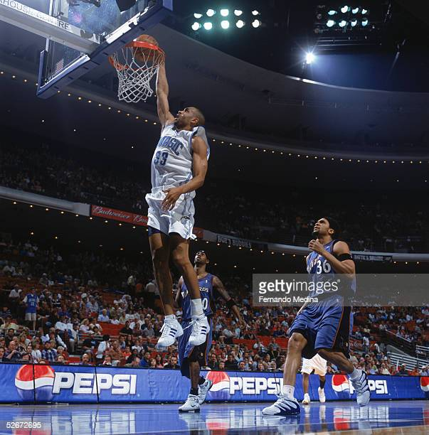 Grant Hill of the Orlando Magic dunks past Etan Thomas of the Washington Wizards during a game at TD Waterhouse Centre on April 1 2005 in Orlando...