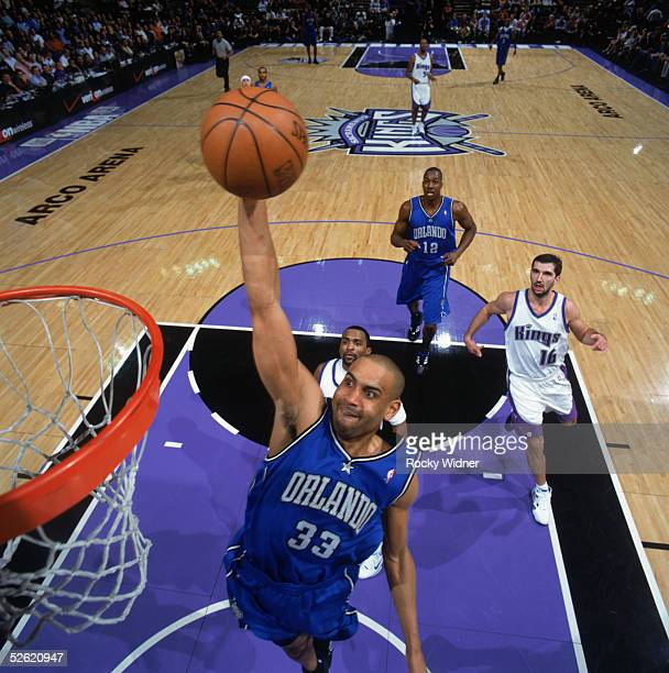 Grant Hill of the Orlando Magic goes for the basket against the Sacramento Kings at Arco Arena on March 15 2005 in Sacramento California The Kings...