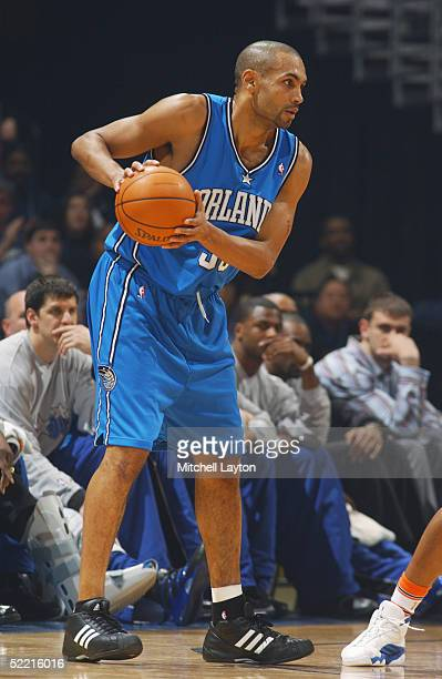 Grant Hill of the Orlando Magic looks to pass during the game with the Washington Wizards January 29 2005 at the MCI Center in Washington DC The...