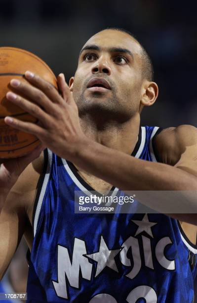 Grant Hill of the Orlando Magic looks to shoot from the freethrow line during the NBA game against the Phoenix Suns at America West Arena on December...