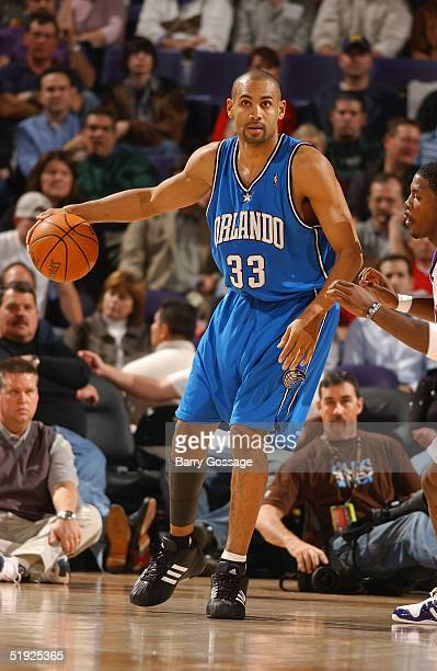 Grant Hill of the Orlando Magic moves the ball against the Phoenix Suns during the game on December 13, 2004 at America West Arena in Phoenix,...