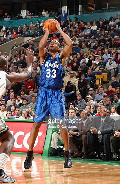 Grant Hill of the Orlando Magic puts up a shot against the Boston Celtics during the NBA game at the FleetCenter on December 9 2002 in Boston...