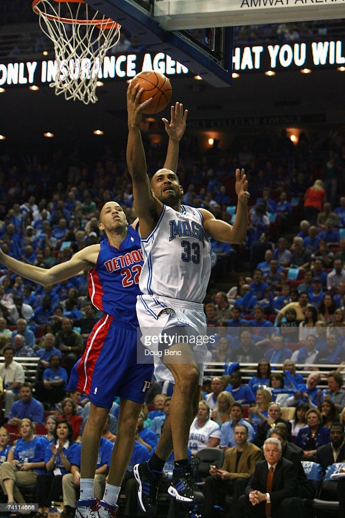 Grant Hill #33 of the Orlando Magic takes the ball to the basket against Chauncey Billups #1 of the Detroit Pistons in Game Three of the Eastern Conference Quarterfinals during the 2007 NBA Playoffs at Amway Arena on April 26, 2007 in Orlando, Florida. The Pistons won 93-77.