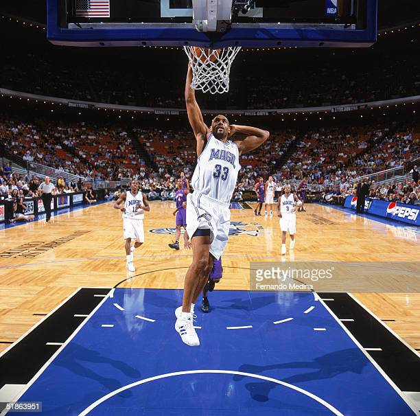 Grant Hill of the Orlando Magic takes the ball to the basket during a game against the Toronto Raptors at TD Waterhouse Centre on December 1 2004 in...