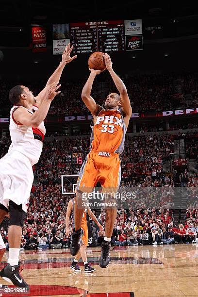 Grant Hill of the Phoenix Suns goes up for a shot over Brandon Roy of the Portland Trail Blazers in Game Four of the Western Conference Quarterfinals...