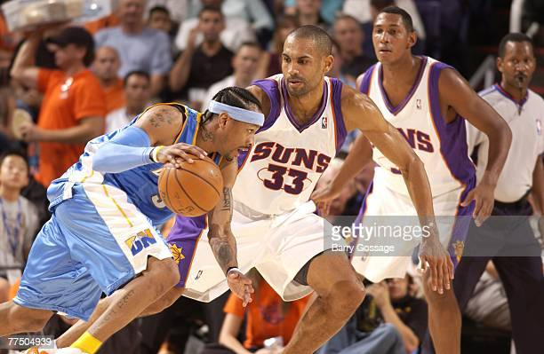 Grant Hill of the Phoenix Suns guards Allen Iverson of the Denver Nuggets in NBA preseason action at US Airways Center on October 25 2007 in Phoenix...