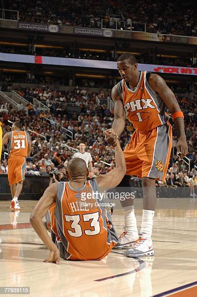 Grant Hill of the Phoenix Suns is helped off the floor by teammate Amare Stoudemire during the game against the Los Angeles Lakers on November 2 2007...