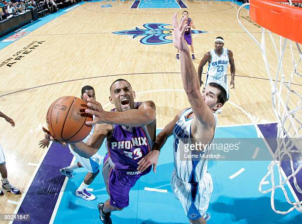 Grant Hill of the Phoenix Suns shoots over Peja Stojakovic of the New Orleans Hornets on November 19 2009 at the New Orleans Arena in New Orleans...