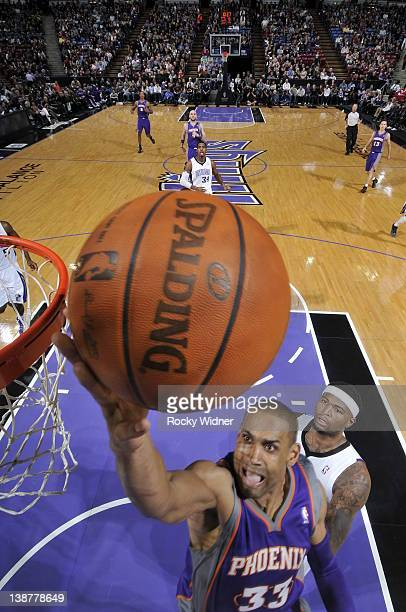 Grant Hill of the Phoenix Suns shoots the ball against DeMarcus Cousins of the Sacramento Kings on February 11 2012 at Power Balance Pavilion in...