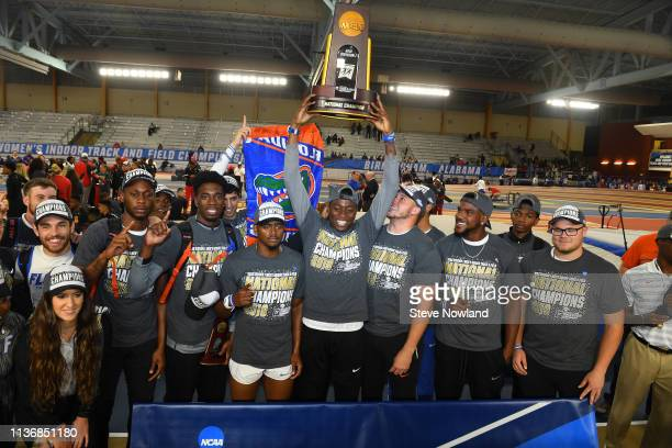 Grant Holloway of the Florida Gators holds the trophy after winning the men's national title during the Division I Men'u2019s and Women'u2019s Indoor...