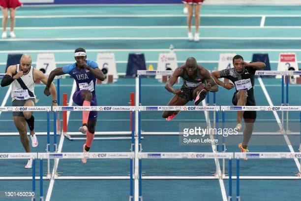 Grant Holloway of the United States competes with Aaron Mallett, Jarret Eaton and Wilhem Belocian in the 60m hurdles final during the World Athletics...