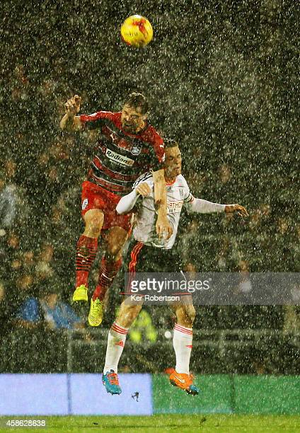 Grant Holt of Huddersfield Town and Scott Parker of Fulham challenge for the ball in the air during the Sky Bet Championship match between Fulham and...