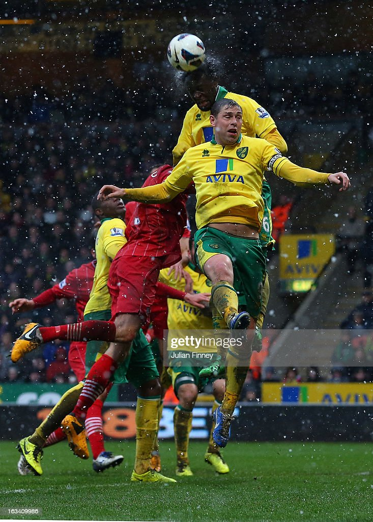 Grant Holt of Norwich City and Kei Kamara of Norwich City jump for a header during the Barclays Premier League match between Norwich City and Southampton at Carrow Road on March 9, 2013 in Norwich, England.