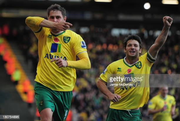 Grant Holt of Norwich City celebrates his goal during the Barlclays Premier League match between Norwich City and Blackburn Rovers at Carrow Road on...