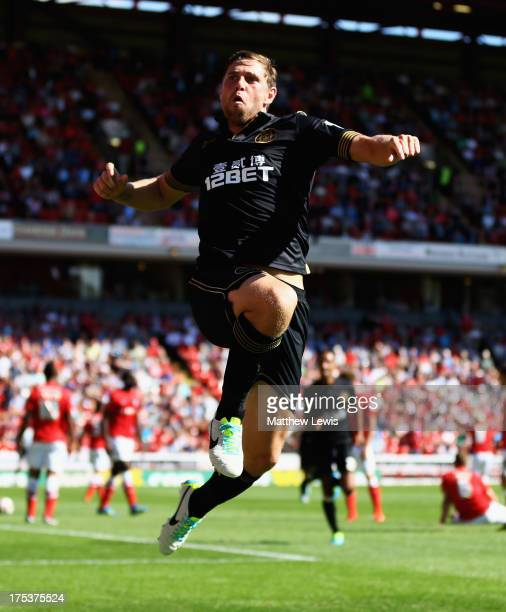 Grant Holt of Wigan Athletic celebrates his goal during the Sky Bet Championship match between Barnsley and Wigan Athletic at Oakwell on August 03,...
