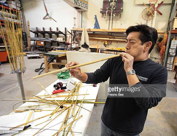 Grant Imahara tests his bamboo blowpipe in preparation for the upcoming ninja myth segment for the cable television show Mythbuster in San Francisco...