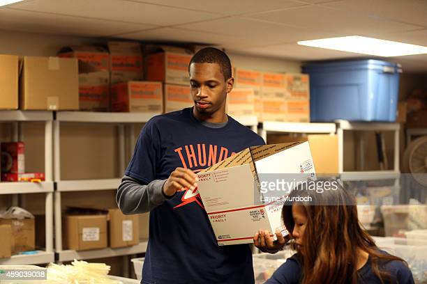 Grant Jerrett Mitch McGary and Lance Thomas along with members of the Oklahoma military and Thunder staff volunteers help pack care packages for The...