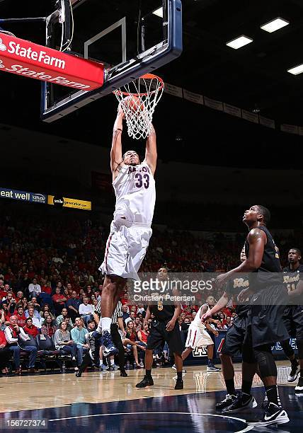 Grant Jerrett of the Arizona Wildcats goes up for a slam dunk against the Long Beach State 49ers during the second half of the college basketball...