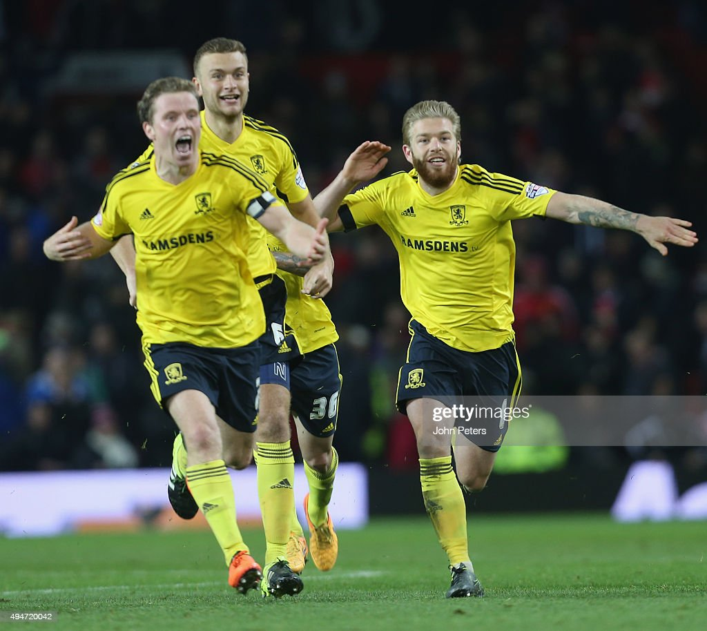 Grant Leadbitter, Ben Gibson and Adam Clayton of Middlesbrough celebrate after the Capital One Cup Fourth Round match between Manchester United and Middlesbrough at Old Trafford on October 28, 2015 in Manchester, England.