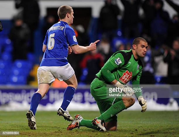 Grant Leadbitter of Ipswich Town celebrates after scoring a goal to make it 10 with a dejected goalkeeper Boaz Myhill of West Bromwich Albion