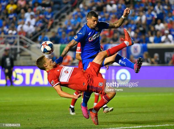 Grant Lillard of Chicago Fire does a bicycle kick to clear the ball in the second half against Milton Caraglio of Cruz Azul at SeatGeek Stadium on...
