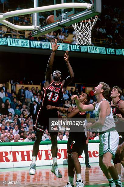 Grant Long of the Miami Heat shoots the ball against Larry Bird of the Boston Celtics during a game played in 1992 at the Boston Garden in Boston...
