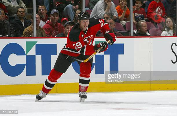 Grant Marshall of the New Jersey Devils skates for the puck during the game against the Pittsburg Penguins at the Continental Airlines Arena on March...