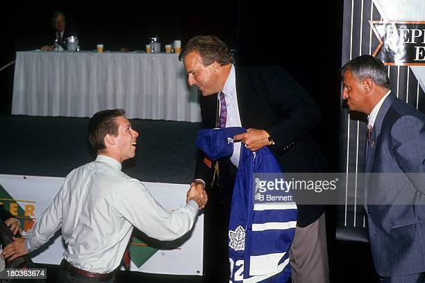 Grant Marshall the 23rd overall pick of the 1992 NHL Draft goes to the stage after being selected by the Toronto Maple Leafs on June 20 1992 at the...