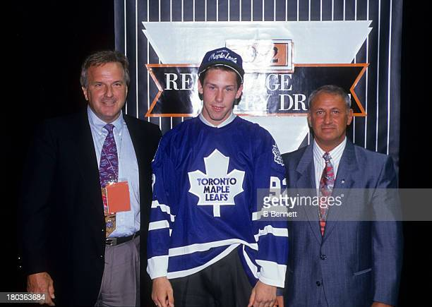 Grant Marshall the 23rd overall pick of the 1992 NHL Draft poses for a portrait on the stage after being selected by the Toronto Maple Leafs on June...