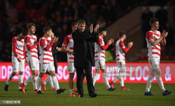 Grant McCann manager of Doncaster Rovers and his players applaud the crowd in defeat after the FA Cup Fifth Round match between Doncaster Rovers and...