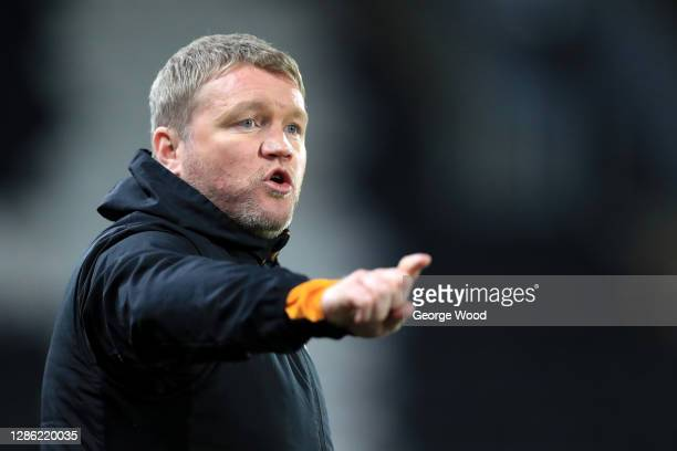 Grant McCann, Manager of Hull City gives his team instructions during the EFL Trophy match between Hull City and Grimsby Town at KCOM Stadium on...