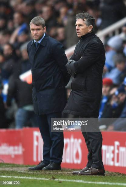 Grant McCann Manager of Peterborough United and Claude Puel Manager of Leicester City look on during The Emirates FA Cup Fourth Round match between...