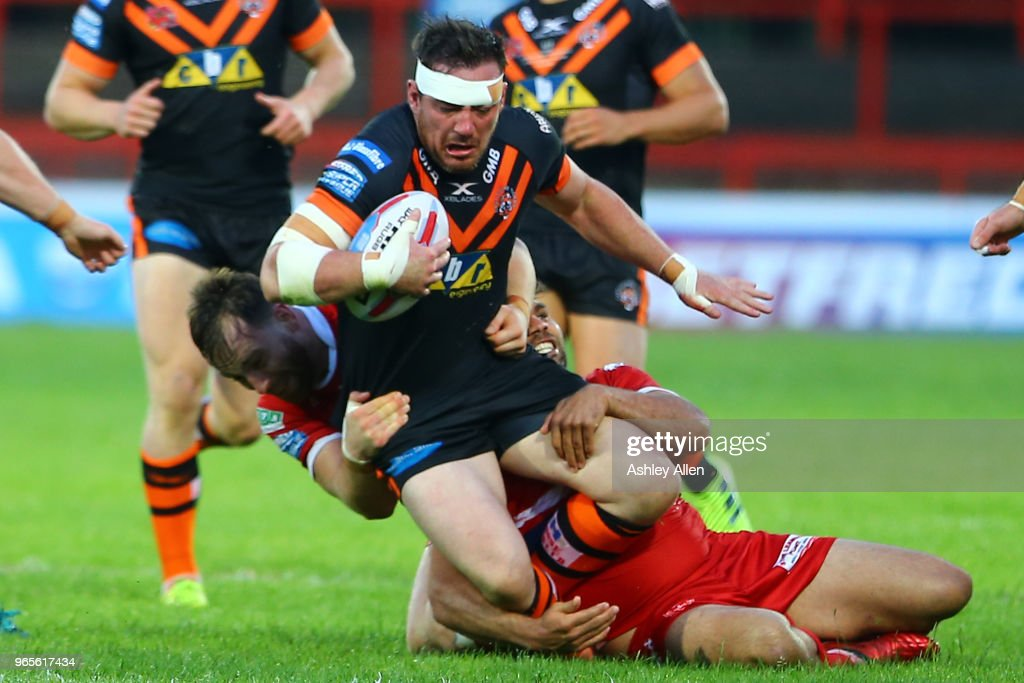 Grant Millington of Castleford Tigers is tackled during the Roger Millward Trophy match between Hull KR and Castleford Tigers as part of the Betfred Super League at KCOM Stadium on June 1, 2018 in Hull, England.
