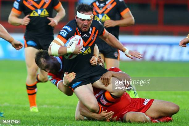 Grant Millington of Castleford Tigers is tackled during the Roger Millward Trophy match between Hull KR and Castleford Tigers as part of the Betfred...
