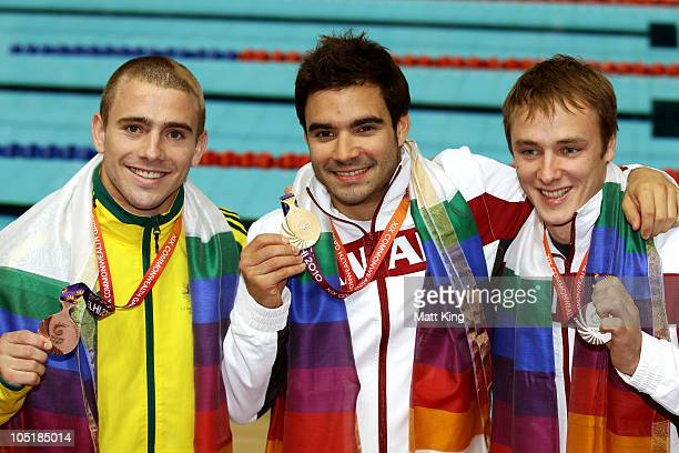 Grant Nel of Australia Alexandre Despatie of Canada and Reuben Ross of Canada pose with the medals won in the Men's 3m Springboard Final at Dr SP...