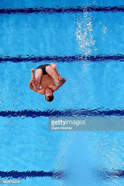 Grant Nel of Australia competes in the Men's 3m Springboard Preliminaries at Royal Commonwealth Pool during day eight of the Glasgow 2014...