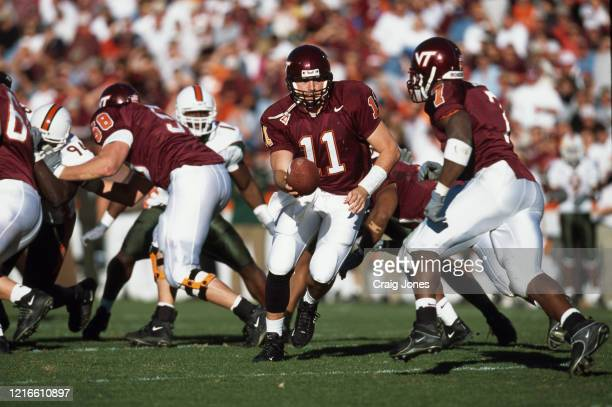 Grant Noel Quarterback for the Virginia Tech Hokies lays the ball off to Running Back Kevin Jones during the NCAA Big East Conference college...