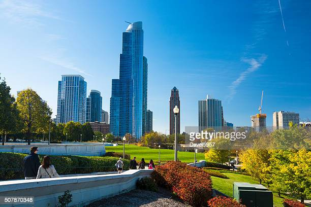 Grant Park, park visitors, and skyscrapers view in Chicago