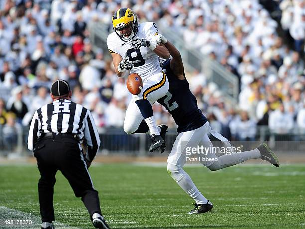 Grant Perry of the Michigan Wolverines has the ball knocked away by Marcus Allen of the Penn State Nittany Lions in the second quarter at Beaver...