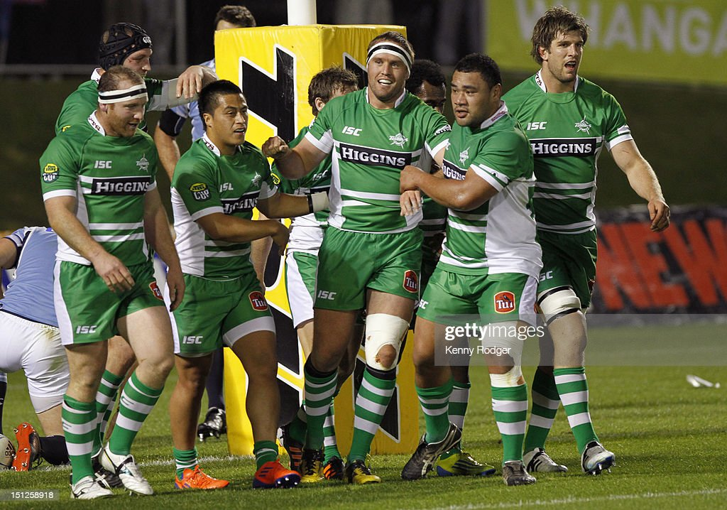 Grant Polson (C) of Manawatu is congratulated after scoring a try during the round four ITM Cup match between Northland and Manawatu at Toll Stadium on September 5, 2012 in Whangarei, New Zealand.